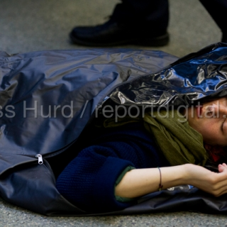 No Borders die-in at St Pancras Eurostar Terminal. Marking the tenth anniversary Frontex, the EU border agency with body bags representing the 20,000 known migrant deaths due to deaths at sea. London. © Jess Hurd/reportdigital.co.uk