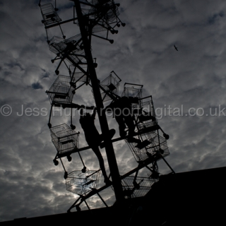 Children climb on a sculpture of shopping trolleys called DNA DL90 on a site opposite an Amazon warehouse. The artwork by Abigail Fallis is part of The Line: East London's new modern art walk. Newham. East London.  © Jess Hurd/reportdigital.co.uk