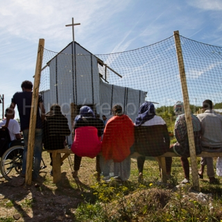 Christian Sunday service for West African migrants in a makeshift church in the Calais refugee camp, known as the jungle. France.  © Jess Hurd/reportdigital.co.uk