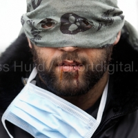 Iranian asylum seekers stitch up their mouths in protest at not beening heard by French authorities demolishing the makeshift Jungle camp. Calais, France.  © Jess Hurd/reportdigital.co.uk