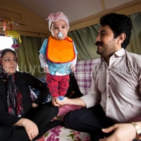 Amir, his wife Maryam and daughter Rosie (3 months), Kurdish refugees in the makeshift Jungle camp prior to a demolition planned by French authorities. Calais, France.© Jess Hurd/reportdigital.co.uk